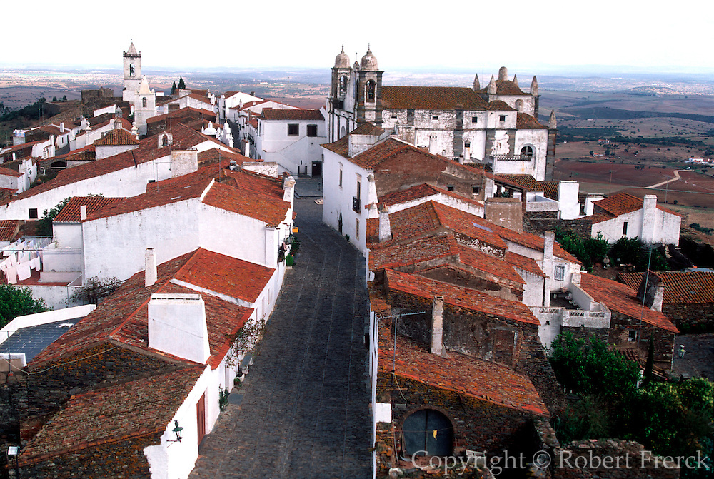 PORTUGAL, ALENTEJO AREA Monsaraz, an ancient walled hilltop village near the border with Spain; view down the main street toward the church