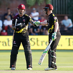 Somerset's Peter Trego celebrates a four with team-mate Steve Davies<br /> <br /> Photographer Simon King/Replay Images<br /> <br /> Vitality Blast T20 - Round 1 - Somerset v Gloucestershire - Friday 6th July 2018 - Cooper Associates County Ground - Taunton<br /> <br /> World Copyright © Replay Images . All rights reserved. info@replayimages.co.uk - http://replayimages.co.uk