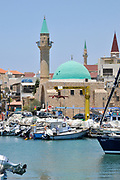 Israel, western Galilee, Acre, The ancient Harbour now a fishing port. El Bahar Mosque in the background