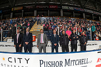KELOWNA, BC - SEPTEMBER 21:  Head coach Adam Foote, assistant coaches Kris Mallette and Vern Fiddler, video coach Adam Brown, athletic therapist Scott Hoyer, equipment manager Chaydyn Johnson and assistant equipment manager Mel Garrett stand on the bench during opening ceremonies against the Spokane Chiefs  at Prospera Place on September 21, 2019 in Kelowna, Canada. (Photo by Marissa Baecker/Shoot the Breeze)