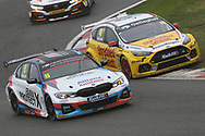 Tom Oliphant and Ollie Jackson battle for track position during the British Touring Car Championship (BTCC) at  Brands Hatch, Fawkham, United Kingdom on 7 April 2019.