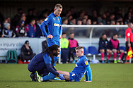 AFC Wimbledon midfielder Max Sanders (23) down injured during the EFL Sky Bet League 1 match between AFC Wimbledon and Peterborough United at the Cherry Red Records Stadium, Kingston, England on 18 January 2020.