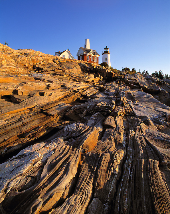 The striated, carved rocks near the Pemaquid Lighthouse in Maine, are a tribute to the power of nature.