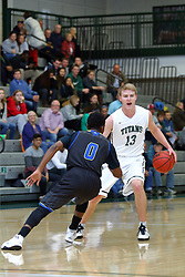 07 December 2016:  Brady Rose protects the ball from T.J. Cobbs during an NCAA men's division 3 CCIW basketball game between the North Park Vikings and the Illinois Wesleyan Titans in Shirk Center, Bloomington IL