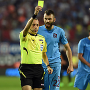 Referee Cuneyt Cakir (R) and Trabzonspor's Mustafa Yumlu (C)during their Turkish Super League Derby match Trabzonspor between Galatasaray at the Avni Aker Stadium at Trabzon Turkey on Saturday, 19 September 2015. Photo by TVPN/TURKPIX
