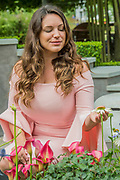 Kelly Brook on the On the Edge:The Centre ofr Mental health Garden - he Hampton Court Flower Show, organised by the Royal Horticultural Society (RHS). In the grounds of the Hampton Court Palace, London.