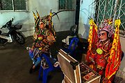 Performers of the Sai Yong Hong chinese opera troupe preparing backstage at Wat Traimit (Temple of the Golden Buddha) in Bangkok's Chinatown, Thailand.