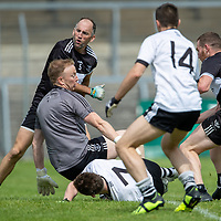 A pile up in the DOonbeg goal mounth as Ennistymon goes for a goal