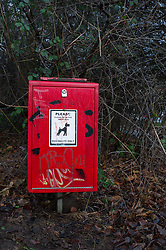 A red box for dog waste