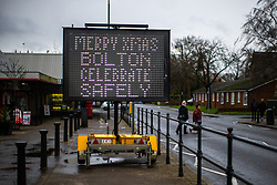 """© Licensed to London News Pictures. 23/12/2020. Bolton, UK. A sign in Bolton reads """" Merry Xmas Bolton celebrate safely """" in reference to current government guidelines for Tier 3 regions that permit three households per Christmas bubble . Guidance is being presented to encourage people to celebrate Christmas safely and minimise the spread of Coronavirus . Photo credit: Joel Goodman/LNP"""