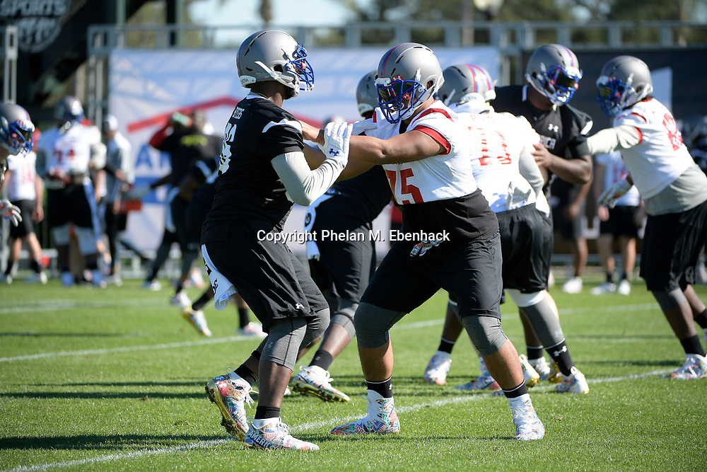 Team Armour offensive tackle Alijah Vera-Tucker (75) works against defensive tackle Akial Byers (96) during a practice for the Under Armour All-America football game in Lake Buena Vista, Fla., Saturday, Dec. 31, 2016. (Photo by Phelan M. Ebenhack)