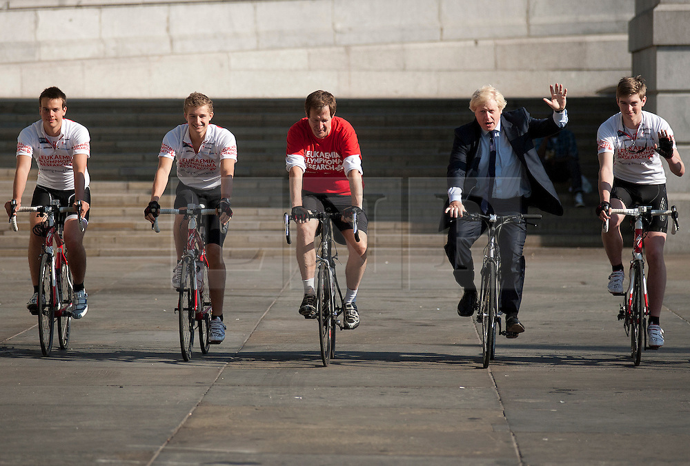 © Licensed to London News Pictures. LONDON, UK  05/07/11. Alastair Campbell, Chairman of Fundraising at Leukaemia and Lymphoma Research, and the Mayor of London, Boris Johnson, ride in Trafalgar Square alongside four school boys who are set to cycle from London to Lisbon in aid of the blood cancer charity. Alastair Campbell, L-R Harry Pearson-Gregory (16), Louise Metcalfe (17), Alastair Campbell, Boris Johnson and Archie Gilmour (17, Boris Johnson's godson), for more information see www.beatbloodcancers.org. Please see special instructions for usage rates. Photo credit should read Matt Cetti-Roberts/LNP
