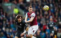 Football - 2019 / 2020 Premier League - Burnley vs. Leicester City<br /> <br /> Canlar Soyuncu of Leicester City and Chris Wood  of Burnley at Turf Moor.<br /> <br /> COLORSPORT