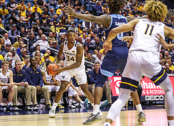 Dec 1, 2019; Morgantown, WV, USA; West Virginia Mountaineers forward Oscar Tshiebwe (34) looks to pass during the second half against the Rhode Island Rams at WVU Coliseum. Mandatory Credit: Ben Queen-USA TODAY Sports