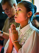 14 DECEMBER 2015 - BANGKOK, THAILAND:   A woman prays for the Supreme Patriarch before the start of his funeral at Wat Bowon Niwet in Bangkok. Somdet Phra Nyanasamvara, who headed Thailand's order of Buddhist monks for more than two decades and was known as the Supreme Patriarch, died Oct. 24, 2013, at a hospital in Bangkok. He was 100. He was ordained as a Buddhist monk in 1933 and appointed as the Supreme Patriarch in 1989. He was the spiritual advisor to Bhumibol Adulyadej, the King of Thailand when the King served as a monk in 1956. His funeral, which will take three days,   Dec. 15-17, will be attended by thousands of Thais and most of the Royal Family. Buddhist clergy from around the world are expected to attend.      PHOTO BY JACK KURTZ