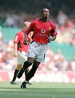 Eric Djemba-Djemba (Utd). Manchester United v Arsenal. Community Shield.10/8/03. Millennium Stadium. Credit : Colorsport/Andrew Cowie.