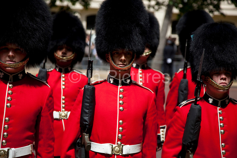 Soldiers of the British Army, on The Mall in London following the ceremonial event, which marks Queen Elizabeth II's official birthday, Trooping the Colour. This June event, part of the 'British Season' of events has all the pomp and ceremony of massed bands, marching Guards in red tunics and the Household Cavalry on horseback.