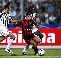Ancona 12/08/2003<br />Trofeo Tim - Tim Cup <br />Filippo Inzaghi Milan, contrastato da Mark Iuliano e Liliam Thuram Juventus<br /><br />Filippo Inzaghi Milan, challenged by Mark Iuliano and Liliam Thuram Juventus