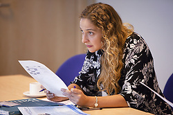 Woman at a teamwork meeting at the NHS Octavia House,
