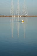 Kayaker in reflection of power lines, Redwood Creek, Redwood City, San Francisco Bay