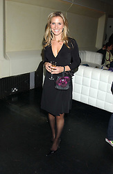 TV sports presenter GEORGIE THOMPSON at a launch party for Kraken Opus's new luxury sports books held at Sketch, 9 Conduit Street, London W1 on 22nd February 2006.<br />