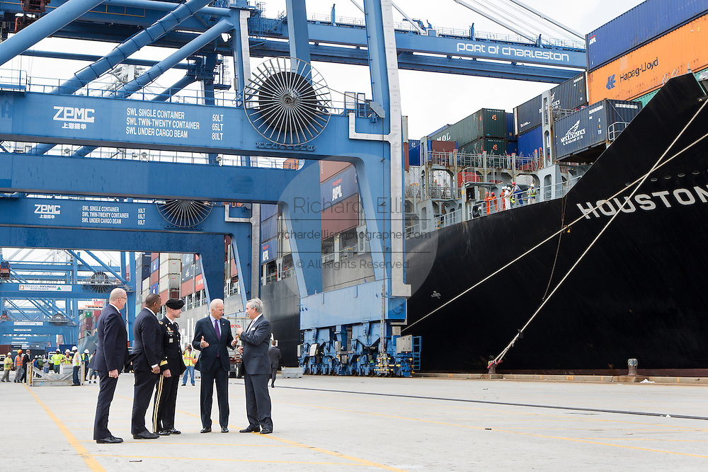 US Vice President Joe Biden speaks with Charleston Ports Authority CEO Jim Newsome, right, General Jackson and Transportation Secretary Anthony Foxx during a visit to Wando Welch Terminal on September 16, 2013 in Charleston, South Carolina. Biden spoke about the need to improve America's transportation infrastructure for exports and economic growth.