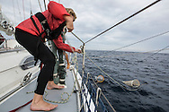 North Atlantic Ocean, September 2014.<br /> Crew member Carrina Gaffney holds one of the trawls used to gather samples on board the Sea Dragon.<br /> © Chiara Marina Grioni
