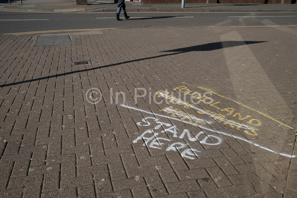 Local response to Coronavirus is felt on a street by street level as 2m customer markings are spray painted onto the pavement outside shops and banks on Kings Heath High Street on 13th April 2020 in Birmingham, England, United Kingdom. Coronavirus or Covid-19 is a new respiratory illness that has not previously been seen in humans. While much or Europe has been placed into lockdown, the UK government has put in place more stringent rules as part of their long term strategy, and in particular social distancing.