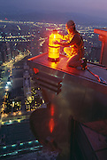 A maintainence worker changes lightbulbs near the dizzying top of Taipei 101, the world's tallest building.