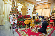 """18 MAY 2010 - BANGKOK, THAILAND: People pay their respects for Seh Daeng at Wat Somanus Tuesday, May 18. The body of Royal Thai Army Maj. General Khattiya """"Seh Daeng"""" Sawasdipol, is lying in repose at Wat Somanus in Bangkok, Thailand. Seh Daeng was widely thought to be the military leader of the Red Shirts. He was credited with ending Thailand's communist insurgency in the 1970's and 80's which made him a folk hero among many people in northeast Thailand. He was shot by an unidentified sniper on May 13 and died on May 17. The anti government Red Shirts have announced a three day mourning period the Seh Daeng.  PHOTO BY JACK KURTZ"""
