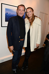 ROBERT HANSON and his wife MASHA MARKOVA at a private view of Photographs by Julian Lennon held at The Little Black Gallery, 13A Park Walk, London SW10 on 17th September 2013.