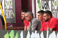 Football - 2018 / 2019 Premier League - Burnley vs. Manchester United<br /> <br /> Manchester United manager Jose Mourinho stays sat in the dugout during the first half at Turf Moor.<br /> <br /> COLORSPORT/PAUL GREENWOOD