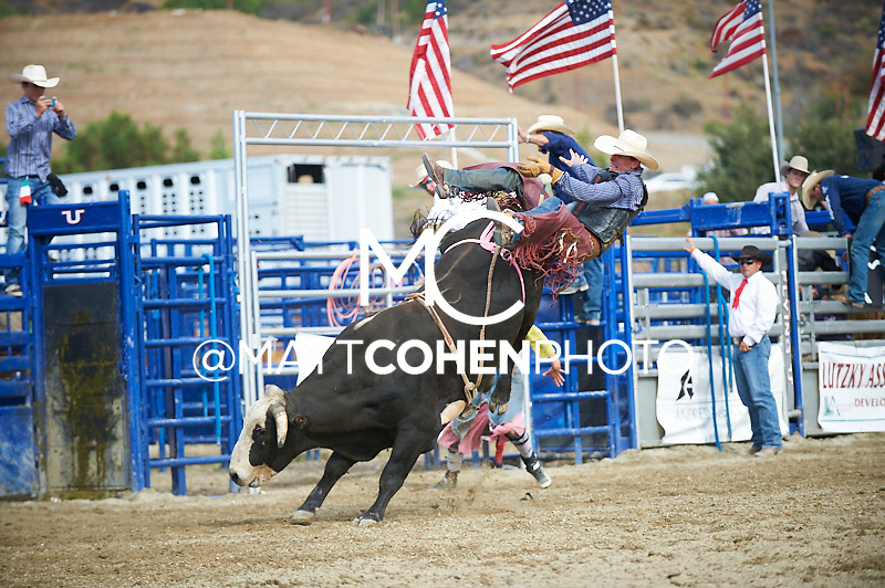 Bull rider Dylan Vick Hice of Escalon, CA rides 357/0 Dark Shadows at the Rancho Mission Viejo Rodeo in San Juan Capistrano, CA.  <br /> <br /> <br /> UNEDITED LOW-RES PREVIEW<br /> <br /> <br /> File shown may be an unedited low resolution version used as a proof only. All prints are 100% guaranteed for quality. Sizes 8x10+ come with a version for personal social media. I am currently not selling downloads for commercial/brand use.