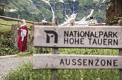 THEMENBILD - eine arabische Touristin geht auf einem Weg. Im Vorderung das Nationalpark Aussenzone Schild. Der Hintersee ist ein kleiner Gebirgssee in 1313 m Höhe im Talschluss des Felbertals in Mittersill. Der Bergsee ist ein Naturdenkmal und wurde unter Schutz gestellt. Der Hintersee gilt als Geheimtipp, Erholungsgebiet und ein Platz, den man gesehen haben muss, aufgenommen am 23. Juni 2019, am Hintersee in Mittersill, Österreich // an Arab tourist goes one way. In front the national park outer zone sign. Hintersee is a small mountain lake 1313 m above sea level at the end of the Felbertal valley in Mittersill. The mountain lake is a natural monument and was placed under protection. The Hintersee is an insider tip, a place you must have seen and a recreation area on 2019/06/23, Hintersee in Mittersill, Austria. EXPA Pictures © 2019, PhotoCredit: EXPA/ Stefanie Oberhauser