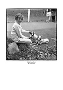Young child with dogs at the Dublin Horse Show.<br /> <br /> 08/08/1961<br /> <br /> 8th August 1961