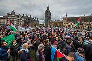 The march arrives in Parliament Square - National Palestine March and Rally - Justice Now: Make it right for Palestine. As the centenary of the Balfour Declaration has just passed on the 2nd November. Speakers addressed the crowd at Grosvenor Square (by the US Embassy) before the march through central London (via Piccadilly Circus and Trafalgar Square). This was followed by a rally in Parliament Square, where speakers again addressed the crowd.