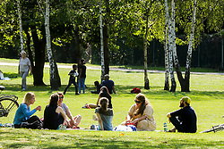© Licensed to London News Pictures. 13/09/2020. London, UK. People in a group and socially distance enjoy warm and sunny weather in Finsbury Park, north London as mini heatwave hits London. Photo credit: Dinendra Haria/LNP