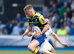 Cardiff Blues' Gareth Anscombe is tackled by Pau's Charly Malie<br /> <br /> Photographer Simon King/Replay Images<br /> <br /> European Rugby Challenge Cup - Semi Final - Cardiff Blues v Pau - Saturday 21st April 2018 - Cardiff Arms Park - Cardiff<br /> <br /> World Copyright © Replay Images . All rights reserved. info@replayimages.co.uk - http://replayimages.co.uk