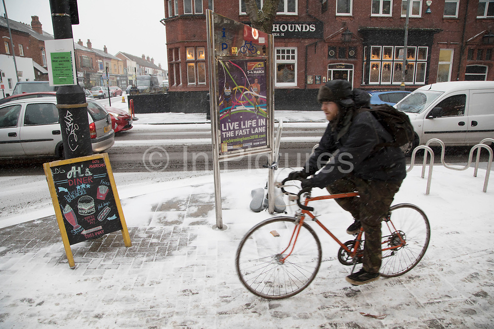 People struggle to go about their daily lives in freezing weather, dubbed 'The Beast from the East' due to the sub zero cold temperature winds coming in from Siberia, descends on Kings Heath High Street on 1st March 2018 in Birmingham, United Kingdom.