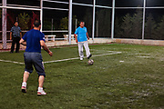 A Syrian fixer who worked for foreign press during the civil war Yasser al-Haji appears to be playing football along with his fellow residents of Marea during routine sports activities at his private football pitch in Marea, the Aleppo Governorate on Monday, June 11, 2012. (Photo by Vudi Xhymshiti)