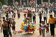 In Cuernavaca's Colonial-era central square (the zócalo found in every Mexican town) city dwellers and visitors take their traditional late-afternoon weekend stroll among the balloon vendors while a band plays on the bandstand.  Hungry Planet: What the World Eats (p. 221). This image is featured alongside the Casales family images in Hungry Planet: What the World Eats.