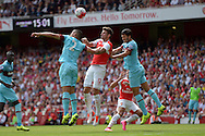 Winston Reid of West Ham United, Olivier Giroud of Arsenal and James Tomkins of West Ham United collide attempting to head the ball. Barclays Premier League, Arsenal v West Ham Utd at the Emirates Stadium in London on Sunday 9th August 2015.<br /> pic by John Patrick Fletcher, Andrew Orchard sports photography.