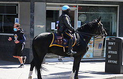 New York mounted police officer on Seventh Avenue during the Covid-19 pandemic in New York City, NY, USA on April 22, 2020. The Big Apple neared a painful milestone Wednesday as the death toll from the coronavirus outbreak that has ravaged the five boroughs approached 15,000. The pandemic has claimed the lives of 14,996 New Yorkers, with new 569 fatalities reported in the most recent 24-hour period, according to data from the city's Department of Health. Photo by Charles Guerin/ABACAPRESS.COM