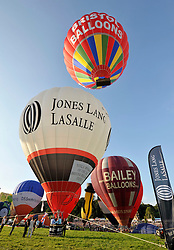 © Licensed to London News Pictures. 09/08/2012. Bristol, UK. The start of the Jones Lang LaSalle Bristol International Balloon Fiesta, which runs from 09-12 August at Ashton Court in Bristol.  This year's fiesta is sponsored by Jones Lang LaSalle. 09 August 2012..Photo credit : Simon Chapman/LNP