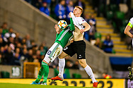 Northern Ireland forward Kyle Lafferty and Estonia defender Madis Vihmann clash on the ball during the UEFA European 2020 Qualifier match between Northern Ireland and Estonia at National Football Stadium, Windsor Park, Northern Ireland on 21 March 2019.