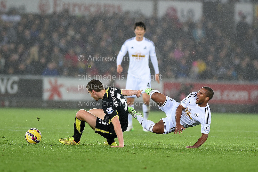 Swansea city's Wayne Routledge is fouled by Tottenham's Jan Vertonghen (5) for which the Tottenham player is booked.  Barclays Premier League match, Swansea city v Tottenham Hotspur at the Liberty Stadium in Swansea, South Wales on Sunday 14th December 2014<br /> pic by Andrew Orchard, Andrew Orchard sports photography.