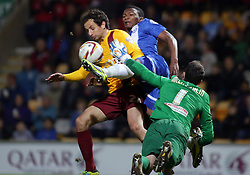 Peterborough United's Kgosi Ntlhe in action with Bradford City's Raffaele De Vita and Jon McLaughlin  - Photo mandatory by-line: Joe Dent/JMP - Mobile: 07966 386802 18/04/2014 - SPORT - FOOTBALL - Bradford - Valley Parade - Bradford City v Peterborough United - Sky Bet League One