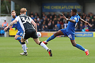 AFC Wimbledon attacker Michael Folivi (41) battles for possession with Gillingham defender Connor Ogilvie (34) during the EFL Sky Bet League 1 match between AFC Wimbledon and Gillingham at the Cherry Red Records Stadium, Kingston, England on 23 March 2019.