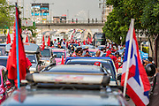08 MAY 2013 - BANGKOK, THAILAND:  A motorcade of Red Shirts goes to the Thai parliament building. A splinter group of the Red Shirts, Thai supporters of exiled Prime Minister Thaksin Shinawatra, have besieged the Thai Constitutional Court for the last three weeks calling for the resignation of the justices, who have indicated they might oppose a proposed constitutional reform which would grant amnesty to people convicted of political crimes since 2007. This would probably include Thaksin. The justices have refused to step down. Wednesday the protesters moved their protest to the Thai Parliament, which is largely powerless to intervene.  PHOTO BY JACK KURTZ
