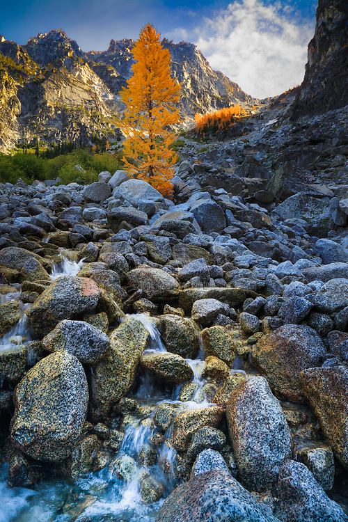 Waterfall along Asgaard pass route to the Enchantment Lakes in Washington with Dragontail Peak in the background